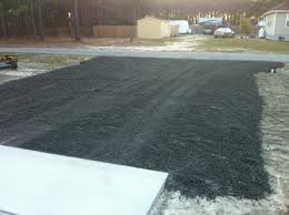 Spreading Recycled Asphalt Roadbase
