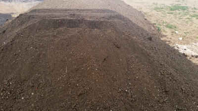 Screened Fill Dirt being processed